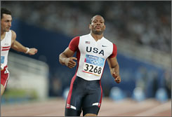 Maurice Greene, shown at the 2004 Olympics in Athens, has been named by a witness in the federal investigation into performance-enhancing drugs, according to a report by The New York Times.