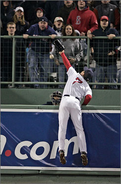 The Red Sox's J.D. Drew just misses a home run hit by the Yankees' Jason Giambi in the eighth inning at Fenway Park. Boston took a 7-1 lead in the third inning and never looked back in the win.