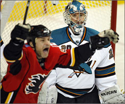 San Jose goalie Evgeni Nabokov reacts to giving up the winning goal late in the third period of the Calgary Flames' 4-3 win on Sunday night as Daymond Langkow celebrates.