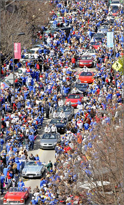 Thousands of Kansas fans filled the streets of downtown Lawrence, Kan., for a parade celebrating the Jayhawks' national championship.