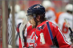 A subdued Alex Ovechkin sits on the bench near the end of the Capitals' 2-0 loss to Philadelphia on Sunday afternoon.