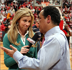 Erin Andrews, shown interviewing former Indiana coach Kelvin Sampson, is quite possibly TV sports' first It Girl.