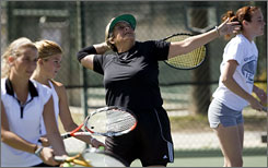 Sheila Johnson works on her serve during practice with the Grand Canyon University women's tennis team at Paseo Racquet Center in Glendale, Ariz. Johnson, 60, returned to college so that she could continue to work with her tennis instructor, Greg Prudhomme, who became coach of the team.
