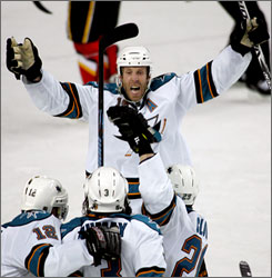 San Jose's Joe Thornton celebrates his game-winning goal with fewer than 10 seconds to play in the Sharks 3-2 win over Calgary on Tuesday. The series is now tied at two games apiece.