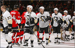 Members of the Pittsburgh Penguins and Ottawa Senators shake hands at the conclusion of their first-round playoff series on Wednesday night. The Penguins won the series in four straight games.
