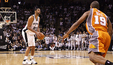 Tim Duncan pauses briefly before shooting and making a rare three-pointer to tie Game 1 and force a second overtime. Duncan scored a game-high 40 points and pulled down 15 rebounds.