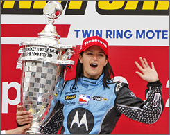 Danica Patrick holds the trophy after winning the Indy Japan 300 to become the first female victor in the history of the IndyCar series.