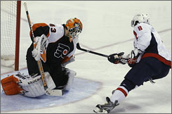 Alexander Ovechkin puts a goal past Flyers goalie  Martin Biron that would prove to be the game-winner as the Capitals tied the series and forced Game 7 with a 4-2 victory.