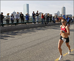 Magdalena Lewy Boulet runs on the Longfellow Bridge with the Boston skyline in the background en route to a second place finish at the women's Olympic marathon trials on Sunday.