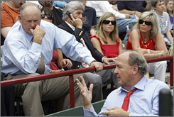 The Rangers owner since 1998, Tom Hicks, right, also a native Texan, talks to his team president at a home game this month.