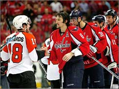 Philadelphia's Mike Richards greets Washington's Alex Ovechkin in the traditional post-series handshake line.