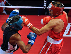 American Olympic hopeful Shawn Estrada (right, fighting Andrew Fermin of Trinidad and Tobago in March) needs to advance to the finals in a Guatemala tournament to clinch an Olympic berth.