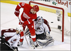Johan Franzen, trying to redirect a shot past Avalanche goalie Peter Budaj in Game 1 of the Western Conference semifinals, leads Detroit with four goals and seven points in the playoffs.