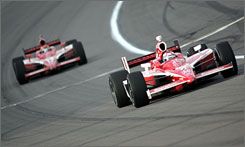 Scott Dixon shows the way ahead of teammate Dan Wheldon during Sunday's race at Kansas Speedway. The two rank second and third, respectively, in IndyCar points.