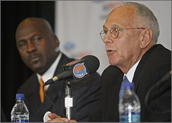 Larry Brown, right, takes his new seat beside Bobcats exec Michael Jordan during Tuesday's news conference.