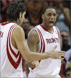 Tracy McGrady, shown giving Luis Scola a high-five, scored 29 points as the Rockets forced a Game 6 with the Jazz in Utah.