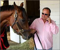 Trainer Richard Dutrow Jr. holds Derby favorite Big Brown.