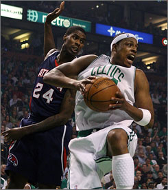 Boston's Paul Pierce grabs a rebound ahead of Atlanta's Marvin Williams during Game 5. Pierce scored a playoff-high 22 points as the Celtics cruised 110-85 to take a 3-2 series lead.