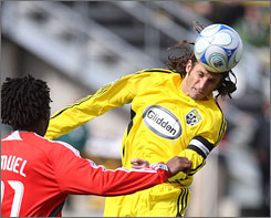 Defender Frankie Hejduk, directing the ball away from Toronto's Collin Samuel, appreciates the Crew's hardcore fans.
