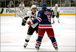 The Rangers' Dan Girardi mixes it up with the Penguins' Sidney Crosby during the third period of Game 4 of the Eastern Conference semifinals in New York. The Rangers won the game 3-0 but still trail in the series 3-1.