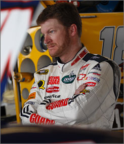 Dale Earnhardt Jr. oversees the work done on his No. 88 Chevy during a break in practice at Richmond.
