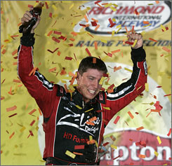 Denny Hamlin soaks in the confetti shower after his first Richmond victory.