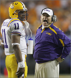 In calmer times ... LSU coach Les Miles talks with quarterback Ryan Perrilloux during the SEC championship game in Atlanta. Friday, Miles and his would-be starting QB parted ways.