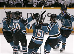 The Sharks celebrate a third-period goal against the Dallas Stars in Game 5 of their Western Conference semifinal in San Jose, Calif. The Sharks won 3-2 in overtime.