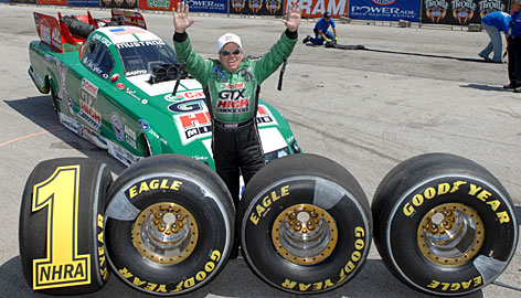 John Force celebrates his 1,000th round win with the help of some well-placed tires.