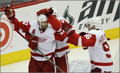 Detroit's Henrik Zetterberg, left, celebrates with teammates Pavel Datsyuk and Tomas Holmstrom, right, after scoring a goal against the Avalanche in the playoffs. The team's best scorers, Zetterberg and Datsyuk are also excellent defenders.