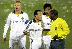 The Galaxy's Landon Donovan leads the appeals to referee Abiodun Okulaja earlier this season.
