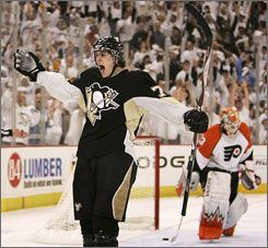 The Penguins' Evgeni Malkin got the puck past Flyers goalie Martin Biron twice, including a second-period shothanded tally to cap the scoring in Game 1 of the Eastern Conference finals.