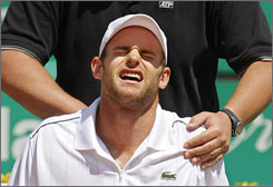 """I warmed up OK, but then just one movement triggered it,"" Andy Roddick said of his back injury. ""I can feel it even when I take a deep breath now."""
