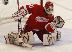 Red Wings goalie Chris Osgood, making a second-period save during Game 2 of the Western Conference finals, has allowed just 12 goals during Detroit's current eight-game playoff winning streak.