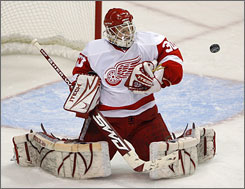 Red Wings goalie Chris Osgood, making a save during Game 3 of the Western Conference finals,  took over the starting role for Detroit  before Game 5 of the first-round series against Nashville.