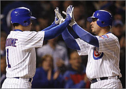 The Cubs' Geovany Soto, right, celebrates with teammate Kosuke Fukudome after hitting a home run against the San Diego Padres in Chicago.