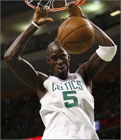 Boston's Kevin Garnett slams in two of his 26 points in the Celtics' Game 5 defeat of the Cavaliers. Garnett also grabbed 16 rebounds as Boston took a 3-2 series lead.