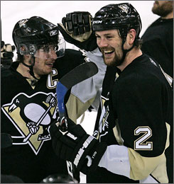 The Penguins' Hal Gill, being congratulated by captain Sidney Crosby after Pittsburgh eliminated the Rangers in the playoffs on May 4, was brought in at the trade deadline from the Maple Leafs.