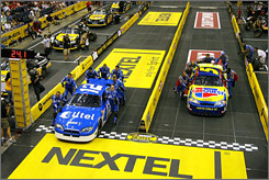 Pit crew members for the No. 12 Alltel Dodge compete vs. the No. 5 Carquest/Kellogg's Chevrolet in last year's competition.