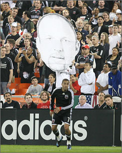D.C. United fans hold up a likeness of head coach Tom Soehn, who is urging a stronger, smarter effort from his team after a 2-5 start.