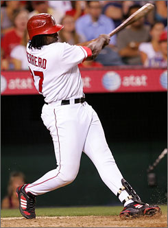 The Angels' Vladimir Guerrero singles in a run against the Dodgers at Angel Stadium of Anaheim.