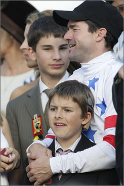 Jockey Kent Desormeaux celebrates his Preakness victory aboard Big Brown with sons Jacob, 9, front, and Joshua, 15.