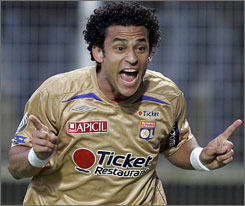 Fred celebrates after scoring Lyon's second goal of the match against Auxerre.
