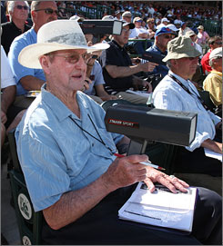Baseball scout Bob Harrison, 87, uses a radar gun to clock a pitcher's velocity during game between San Francisco Giants and Arizona Diamondbacks. Harrison, who signed 27 players who reached the big leagues, won't quit. &quot;This is my life,&quot; he said.