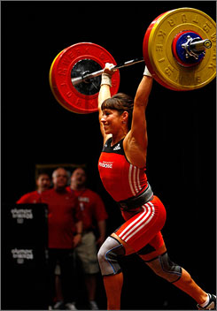 Melanie Roach completes a clean and jerk lift at the U.S. weightlifting trials in Atlanta over the weekend. Roach was a contender to make the team in 2000 but missed the trials due to a back injury.