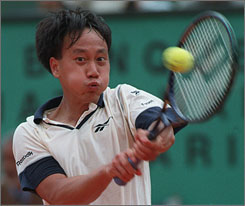 In 1989, Michael Chang became the first American since 1955 to win the French Open. Here, he plays a shot during the 1997 event before retiring from professional tennis in 2003.