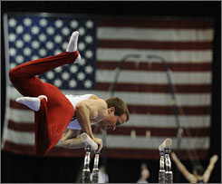 Paul Hamm injured his right hand when he fell off the parallel bars during the first night of competition at the Visa Championships.