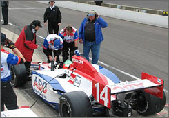 A.J. Foyt and his crew keep watch over Darren Manning's car on pit road during the final practice day at Indy.
