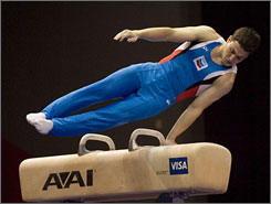 David Sender competes on the pommel horse during the final round of the Visa Championships in Houston. Sender won the all-around title with a score of 180.70 and advanced to the U.S. Olympic Trials next month in Philadelphia.
