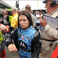 Danica Patrick storms through the pit area after an on-track altercation with Ryan Briscoe.